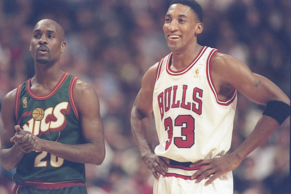 Scottie Pippen smiles as he waits for a free throw.