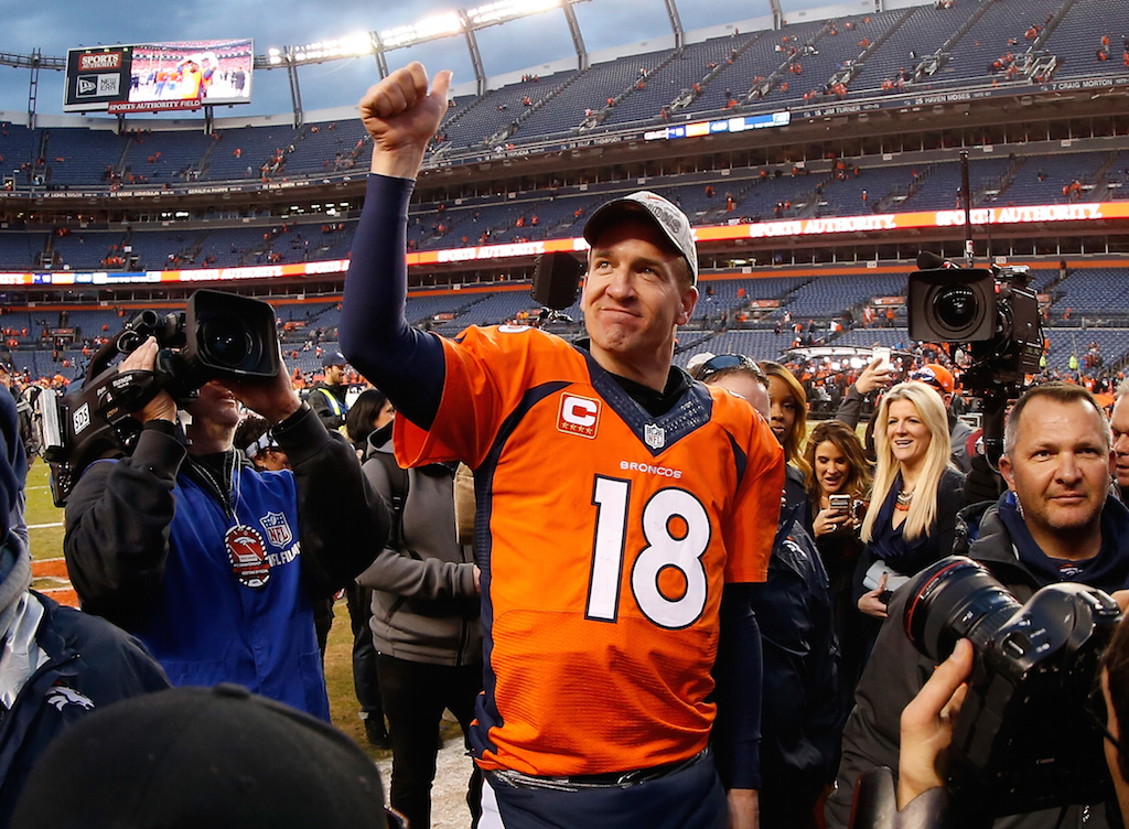 Peyton Manning #18 of the Denver Broncos walks off the field after defeating the New England Patriots in the AFC Championship game