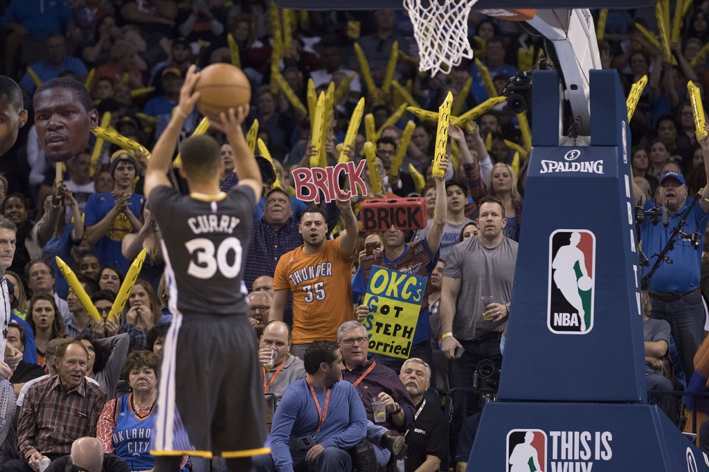 OKLAHOMA CITY, OK - FEBRUARY 27: Oklahoma City Thunder fans try to distract Stephen Curry #30 of the Golden State Warriors as he shoots a free throw during the third period of a NBA game at the Chesapeake Energy Arena on February 27, 2016 in Oklahoma City, Oklahoma. The Warriors won 121-118 in overtime.