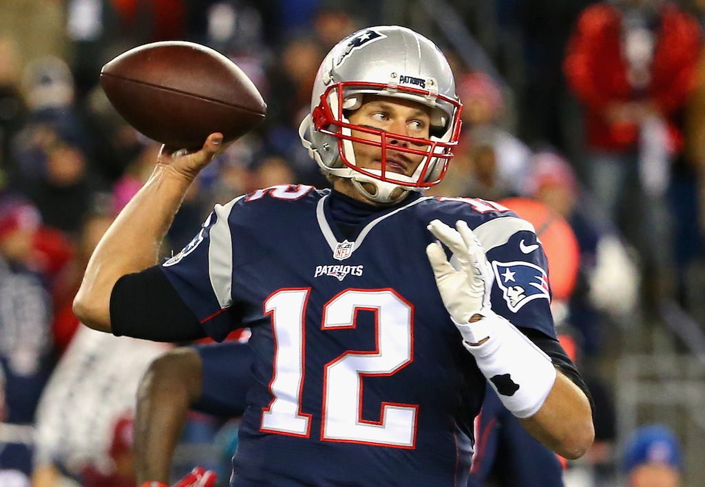 Tom Brady looks at his receiver as he throws a pass.