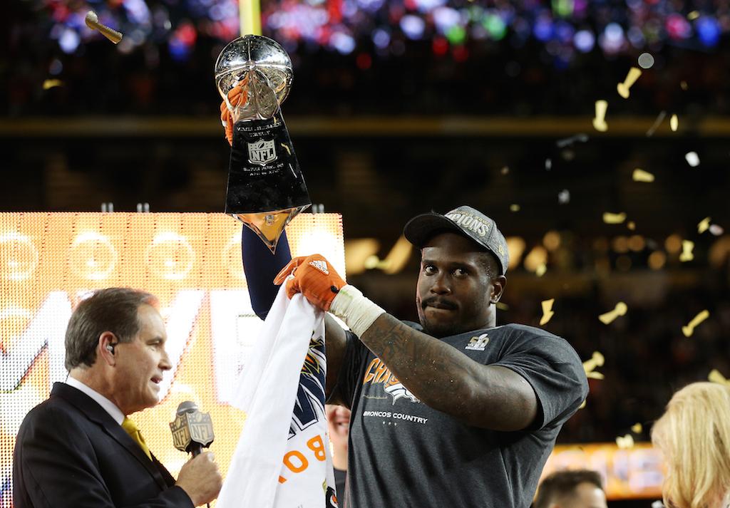 Super Bowl MVP Von Miller #58 of the Denver Broncos celebrates with the Vince Lombardi Trophy after winning Super Bowl 50.