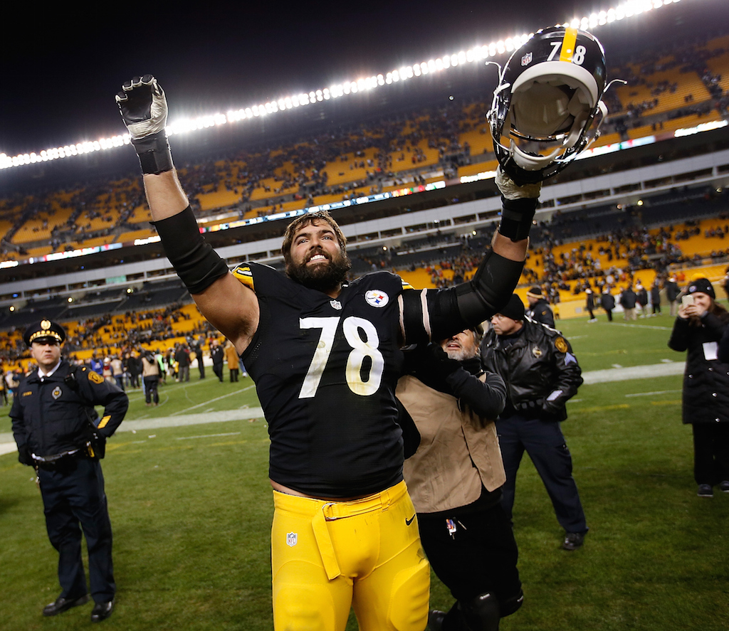 The Pittsburgh Steelers' Alejandro Villaneuva celebrates a win.