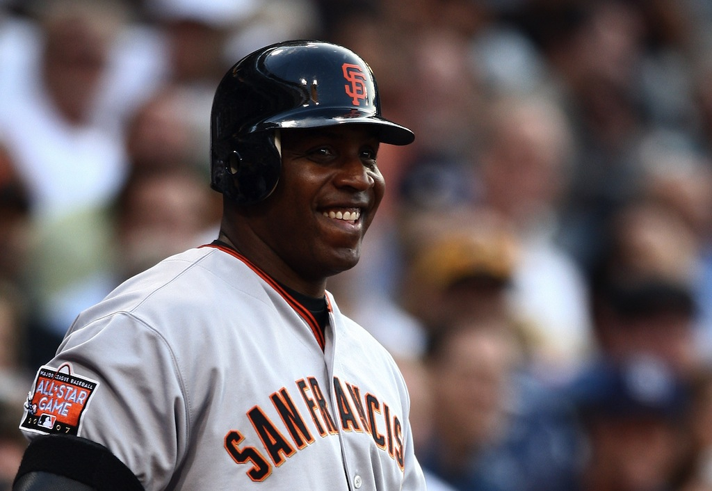 Barry Bonds laughs as he steps up to the plate.
