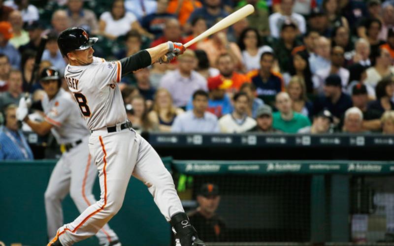 Buster Posey follows through on a home run.