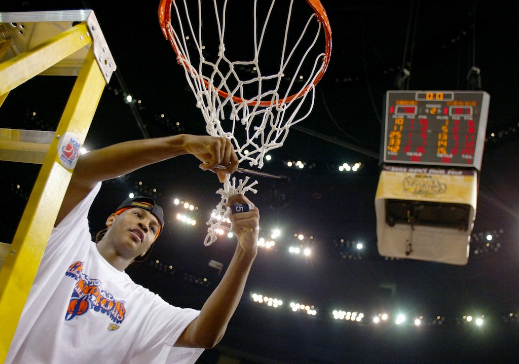 Carmelo Anthony cuts down the net after winning the NCAA championship.