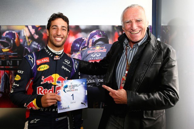 Dietrich Mateschitz stands with a Red Bull Racing driver.