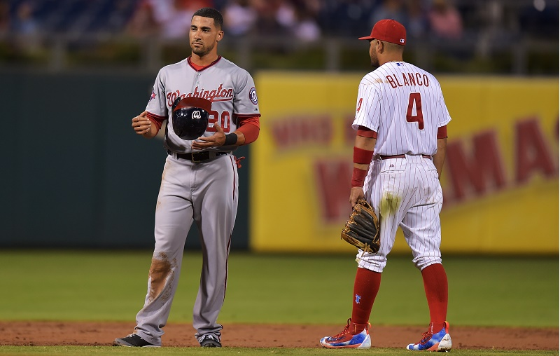 PHILADELPHIA, PA - SEPTEMBER 16: Washington Nationals and Andres Blanco #4 of the Philadelphia Phillies wait for the results of a replay in the second inning at Citizens Bank Park on September 16, 2015 in Philadelphia, Pennsylvania. (Photo by Drew Hallowell/Getty Images)