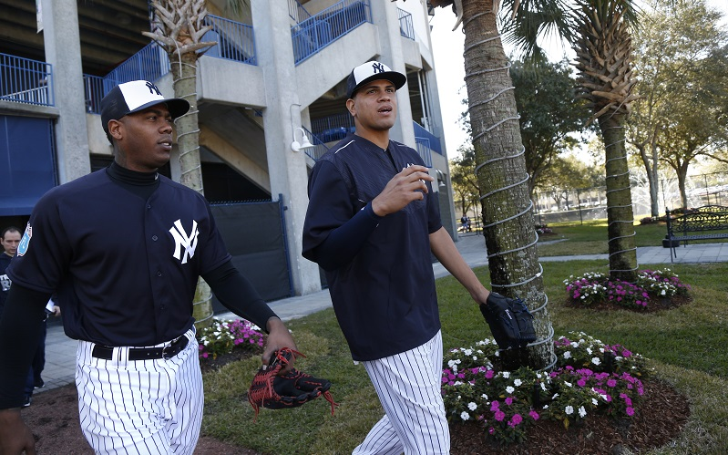 TAMPA, FL - FEBRUARY 19: Pitchers Aroldis Chapman, left, and Dellin Betances, of the New York Yankees, walk out to the field to participate in a spring training workout on February 19, 2016 at George M. Steinbrenner Field in Tampa, Florida. (Photo by Brian Blanco/Getty Images) *** Local Caption *** Aroldis Chapman, Dellin Betances