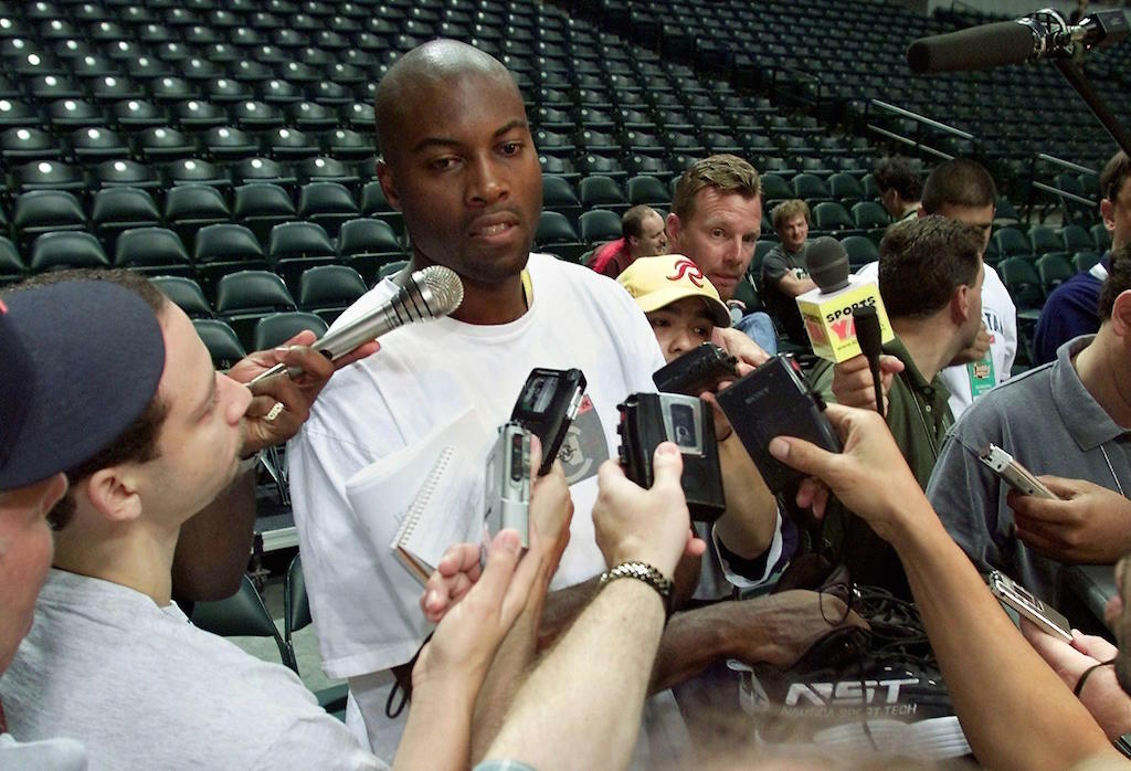 Glen Rice talks to reporters.