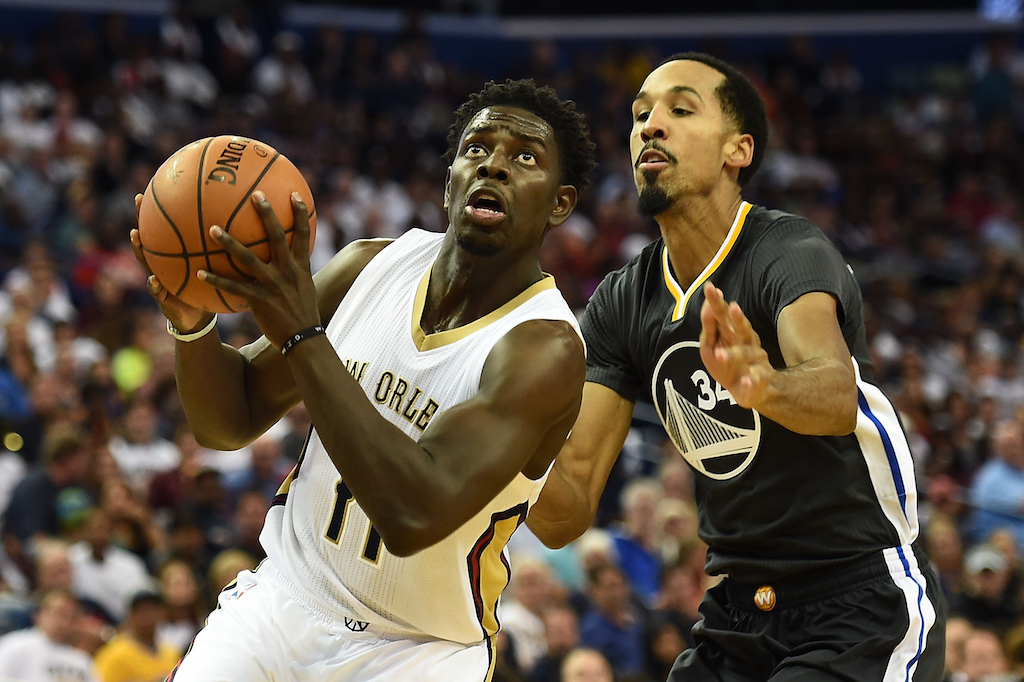 Jrue Holiday of the New Orleans Pelicans is defended by Shaun Livingston of the Golden State Warriors. (Photo by Stacy Revere/Getty Images)