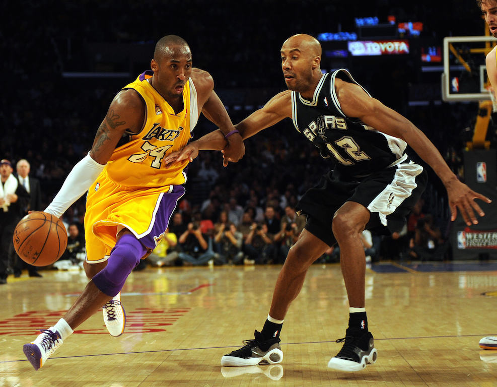 Pau Gasol (R) of the Los Angeles Lakers moves the ball before Bruce Bowen of the San Antonio Spurs in Game Two of the Western Conference Finals during the 2008 NBA Playoffs on May 21, 2008 at Staples Center in Los Angeles, California. (Gabriel Bouys/AFP/Getty Images)