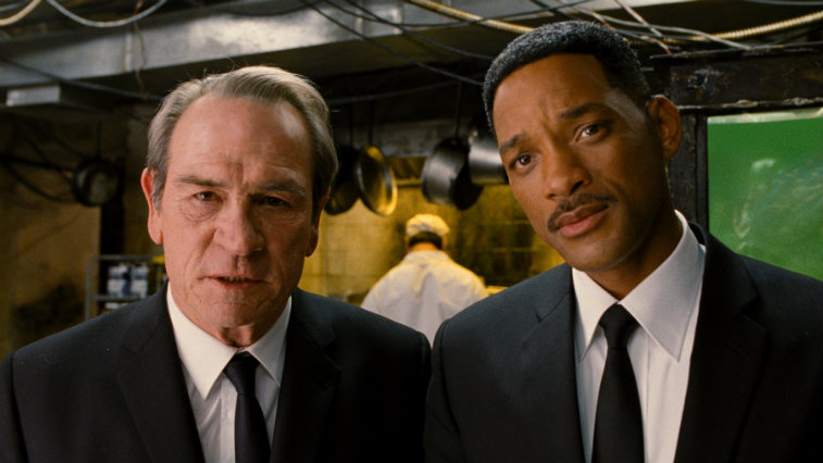 Tommy Lee Jones and Will Smith on set of a movie.