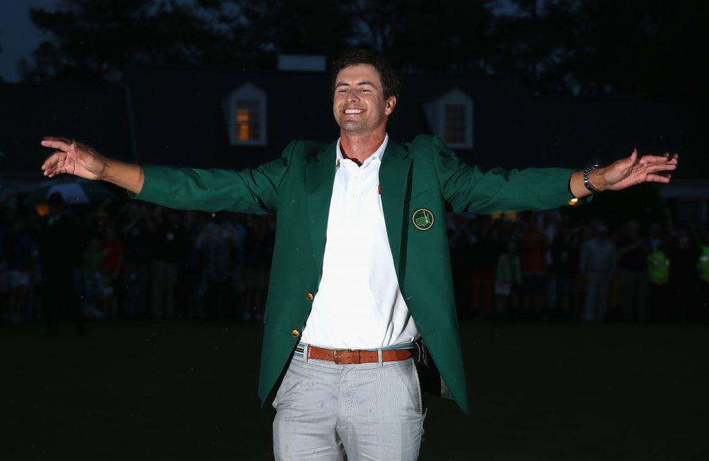 Adam Scott celebrates his green jacket.