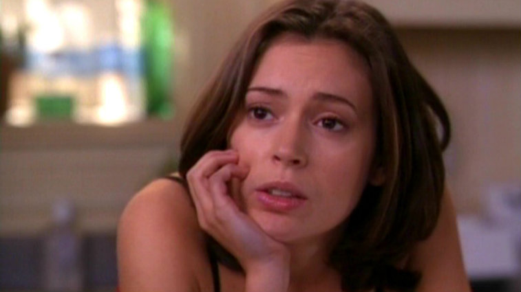 Alyssa Milano acts in Charmed.