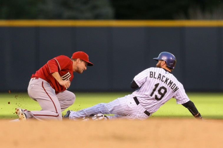 Charlie Blackmon of the Colorado Rockies slides to the base against the Arizona Diamondbacks.