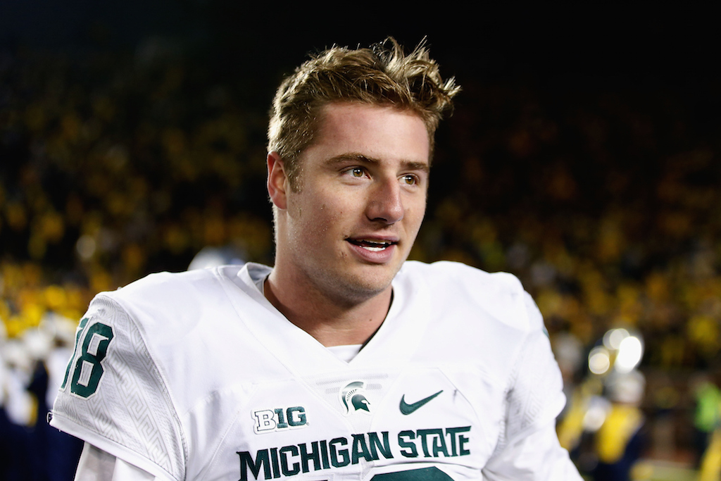 ANN ARBOR, MI - OCTOBER 17: Quarterback Connor Cook #18 of the Michigan State Spartans walks off the field after defeating the Michigan Wolverines 27-23 in the college football game at Michigan Stadium on October 17, 2015 in Ann Arbor, Michigan.