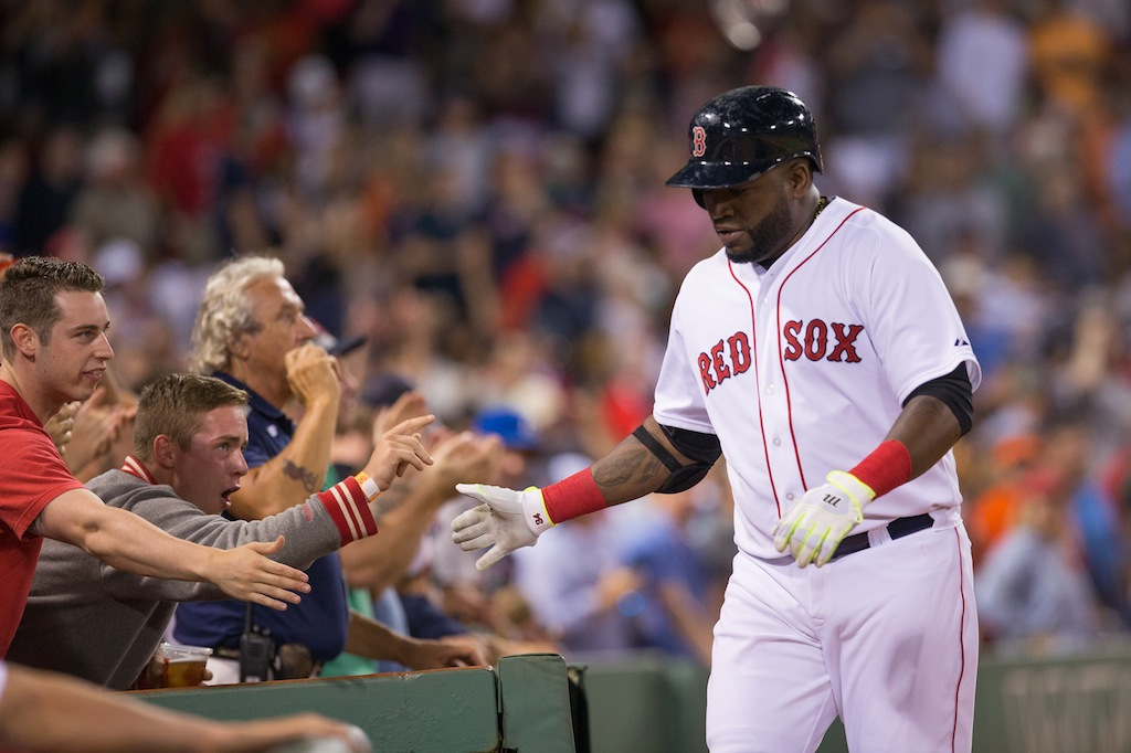 Boston's David Ortiz celebrates a home run with some fans. | Rich Gagnon/Getty Images