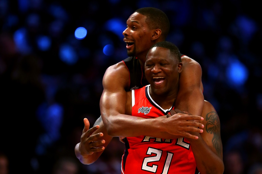 Chris Bosh (L) and Dominique Wilkins celebrate during the 2015 NBA All-Star Game | Elsa/Getty Images