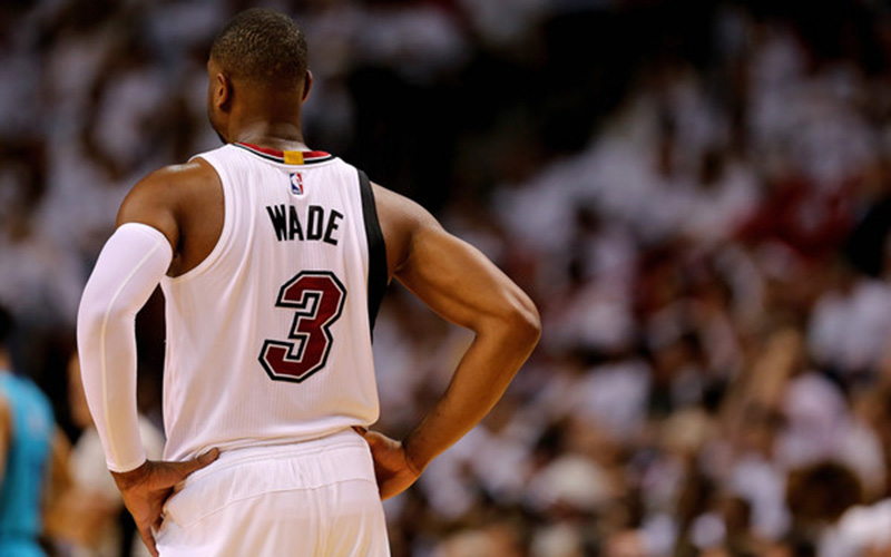 Dwyane Wade stands on the court.