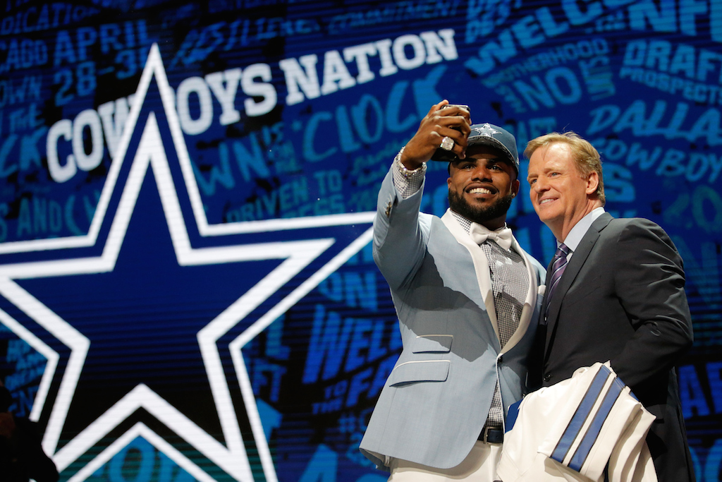 Ezekiel Elliott snaps a selfie with commissioner Roger Goodell (R). | Jon Durr/Getty Images