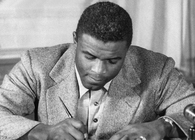 Jackie Robinson signing his record contract