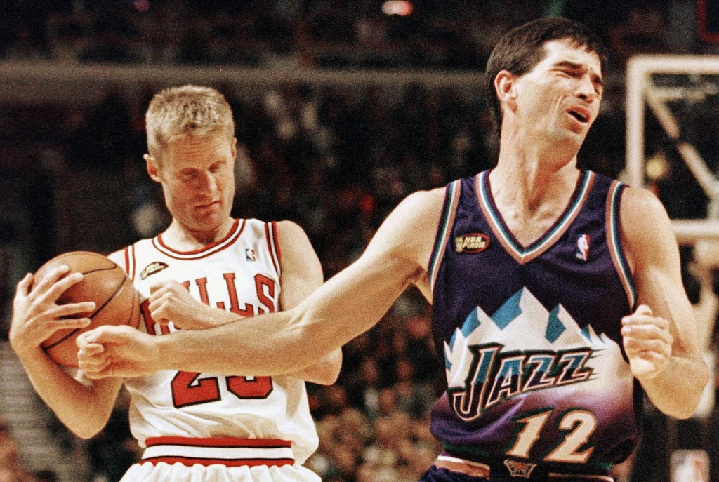 Utah's John Stockton (R) reacts to being called for a foul.