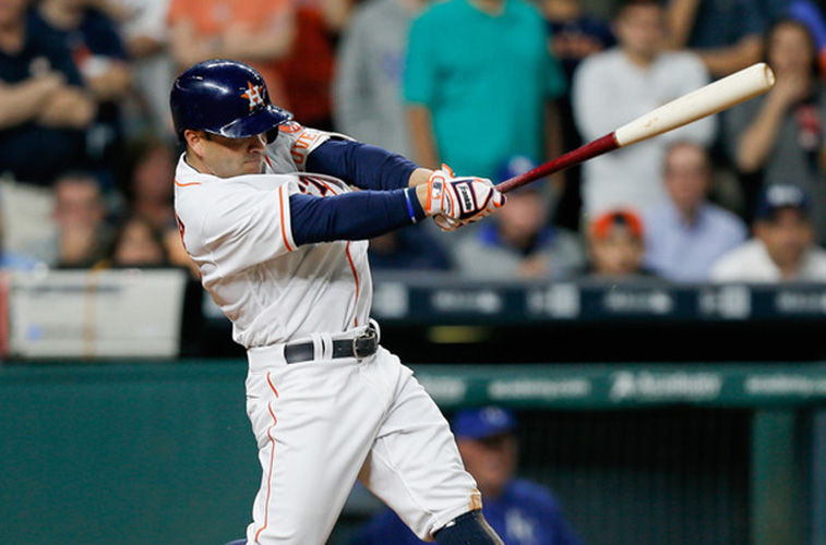 Jose Altuve follows through.