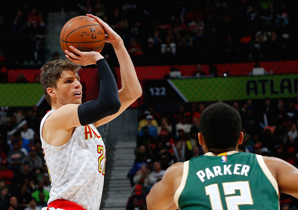 Kyle Korver attempts a three-point shot.