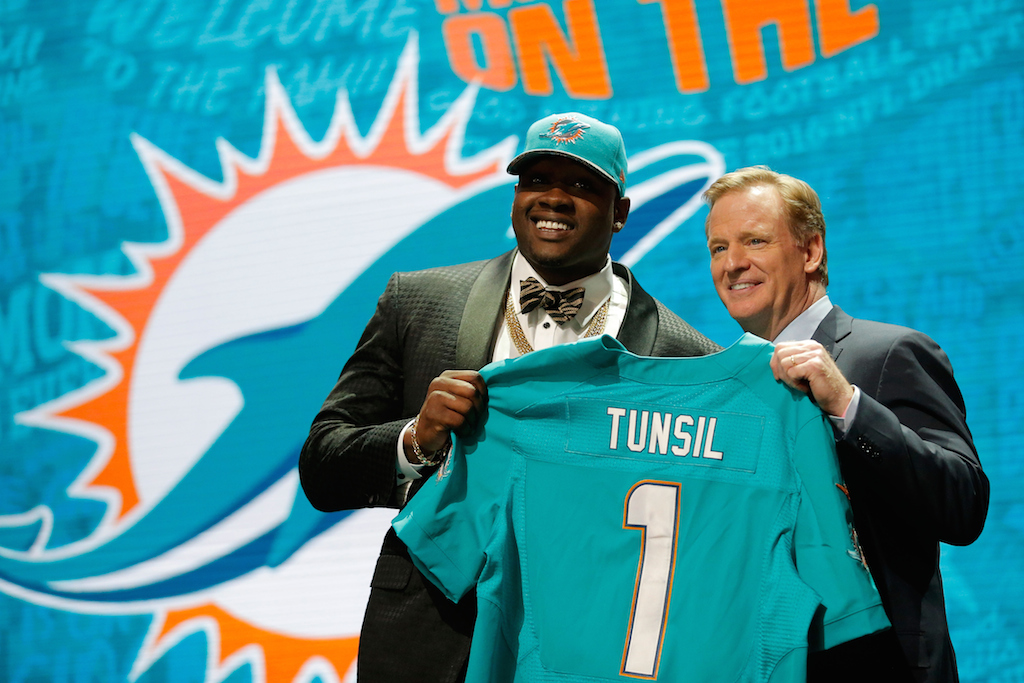 Laremy Tunsil is selected No. 13 by the Miami Dolphins. | Jon Durr/Getty Images