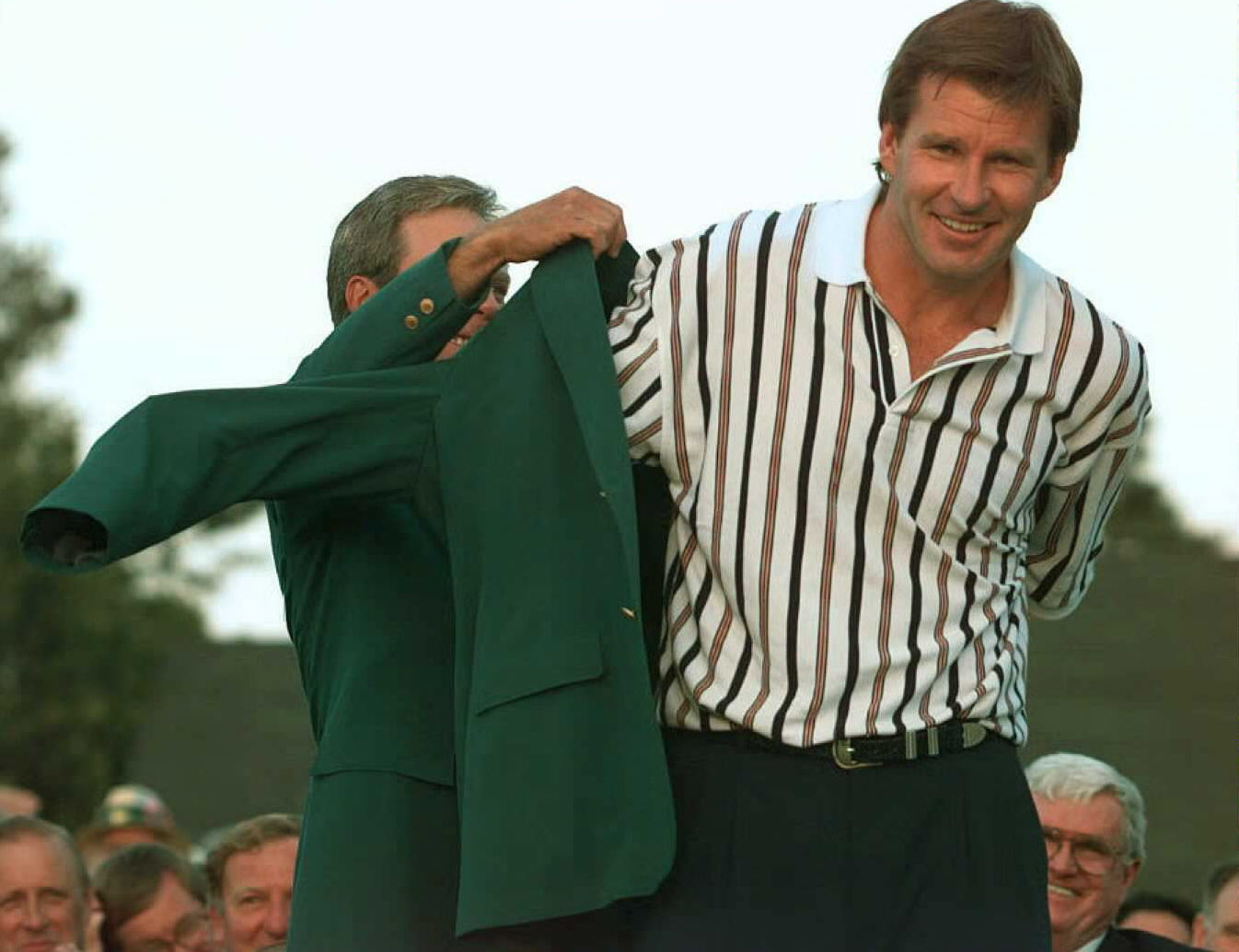 Nick Faldo dons his green jacket.