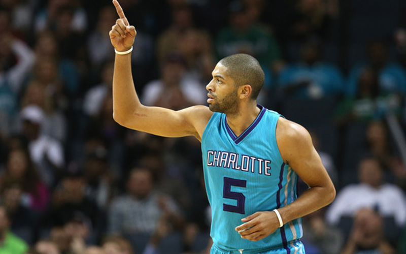 Nicolas Batum points to the sky and motions for his teammates.