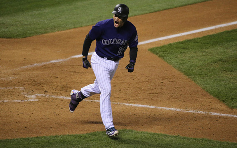 Nolan Arenado rounds the bases on a home run.
