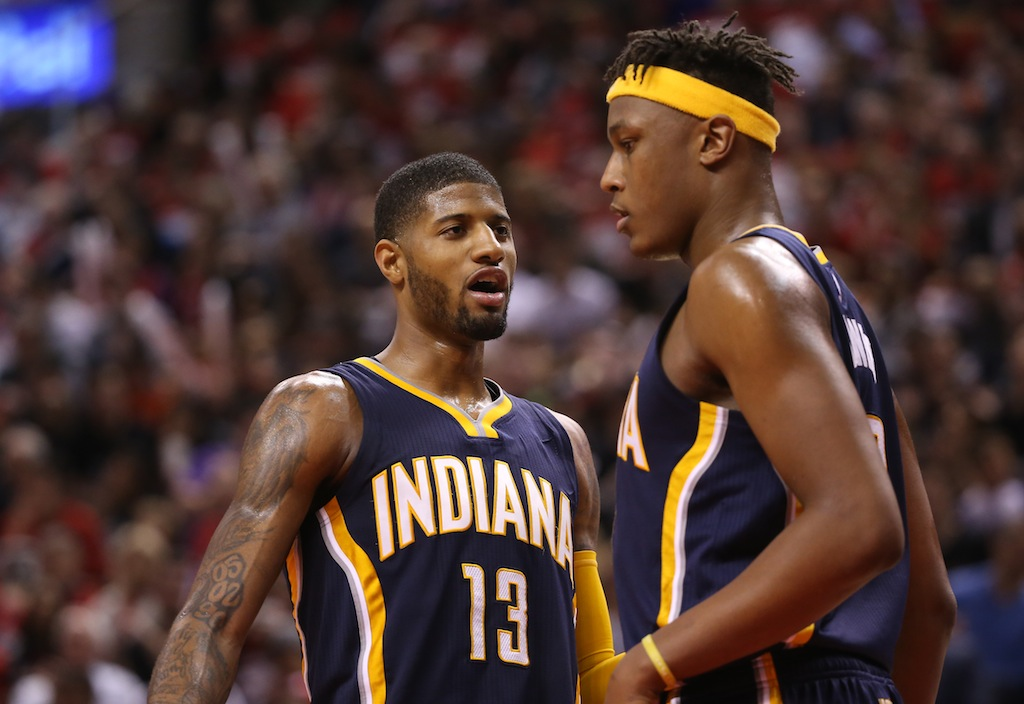 Paul George #13 chats with Myles Turner.