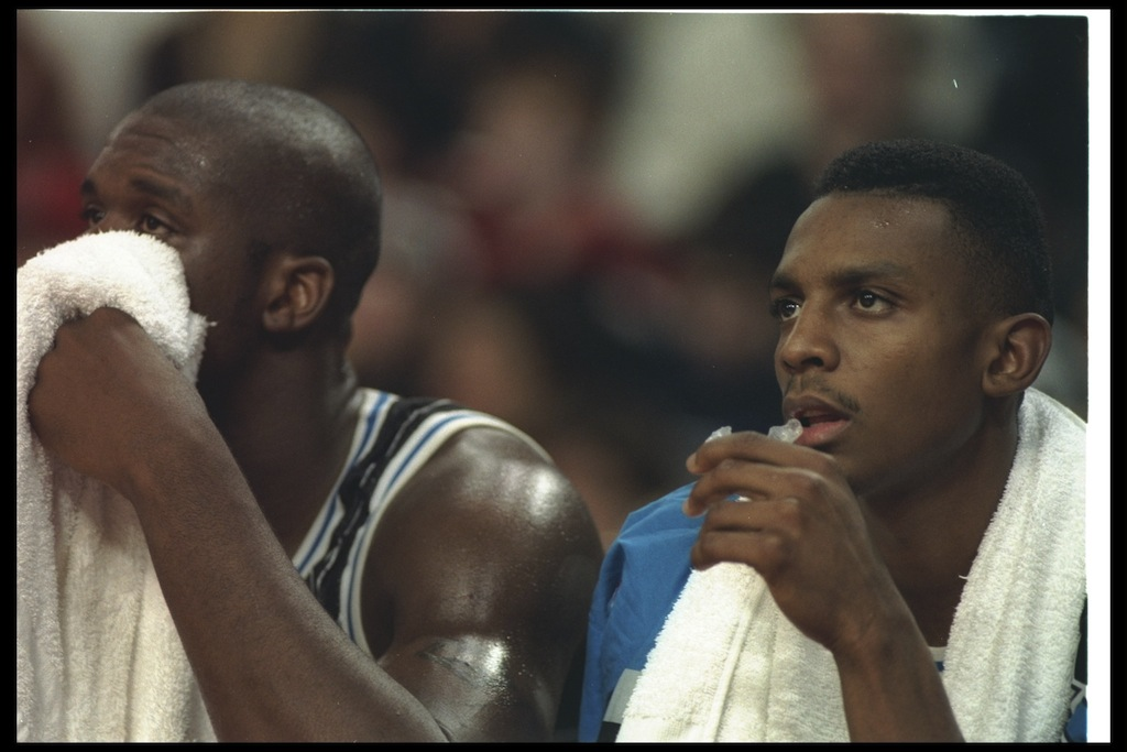 Shaquille O'Neal and Penny Hardaway sit on the Magic bench.