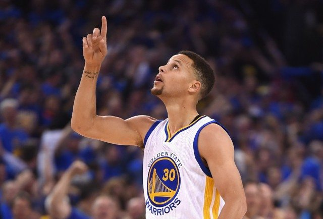 Stephen Curry gestures to the sky during a game against the Grizzlies. | Thearon W. Henderson/Getty Images