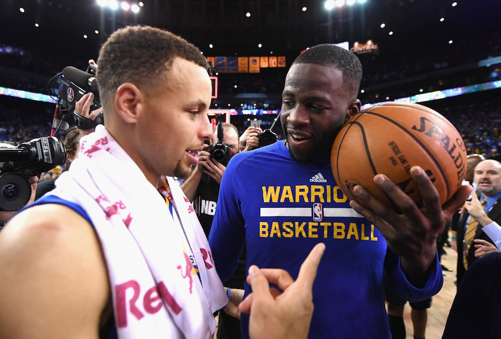 Stephen Curry (L) and Draymond Green celebrate the Warriors' 73rd win of the season. | Thearon W. Henderson/Getty Images