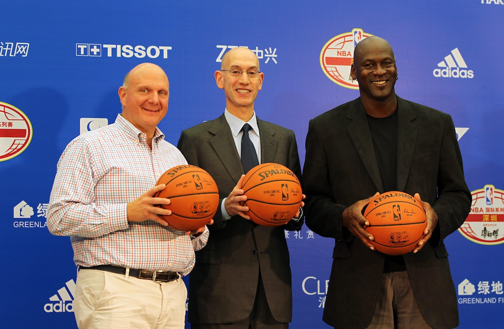 Clippers owner Steve Ballmer (L), commissioner Adam Silver, and Hornets owner Michael Jordan speak to the media.   Zhong Zhi/Getty Images