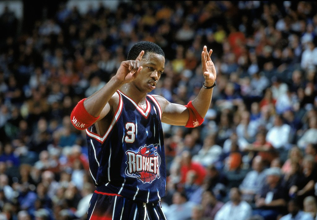 Houston's Steve Francis signals on the court.