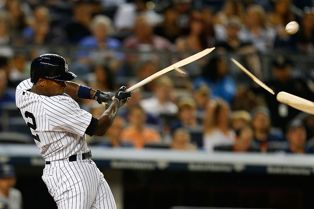 Alfonso Soriano of the New York Yankees breaks his bat fouling the ball off in the sixth inning against the Seattle Mariners at Yankee Stadium on June 2, 2014 in the Bronx borough of New York City.