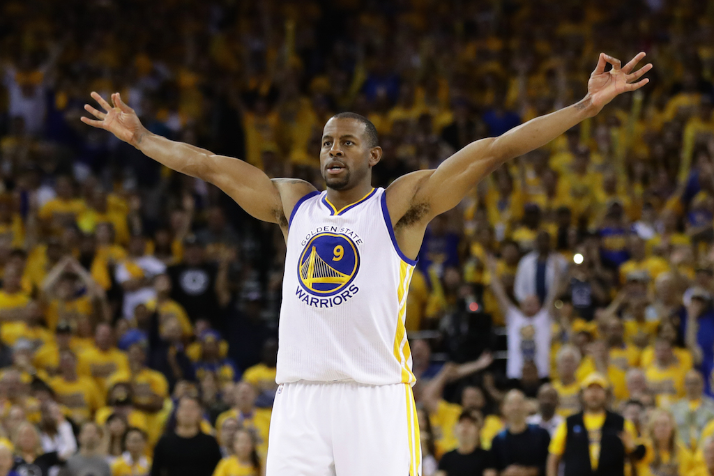 Andre Iguodala celebrates after knocking down a triple.
