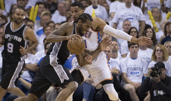 Oklahoma City's Andre Roberson defends San Antonio's Kawhi Leonard. | J Pat Carter/Getty Images Thunder