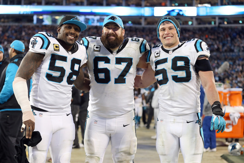 CHARLOTTE, NC - JANUARY 24: Thomas Davis #58, Ryan Kalil #67 and Luke Kuechly #59 of the Carolina Panthers pose on the sidelines during the NFC Championship Game against the Arizona Cardinals at Bank of America Stadium on January 24, 2016 in Charlotte, North Carolina. (Photo by Streeter Lecka/Getty Images)