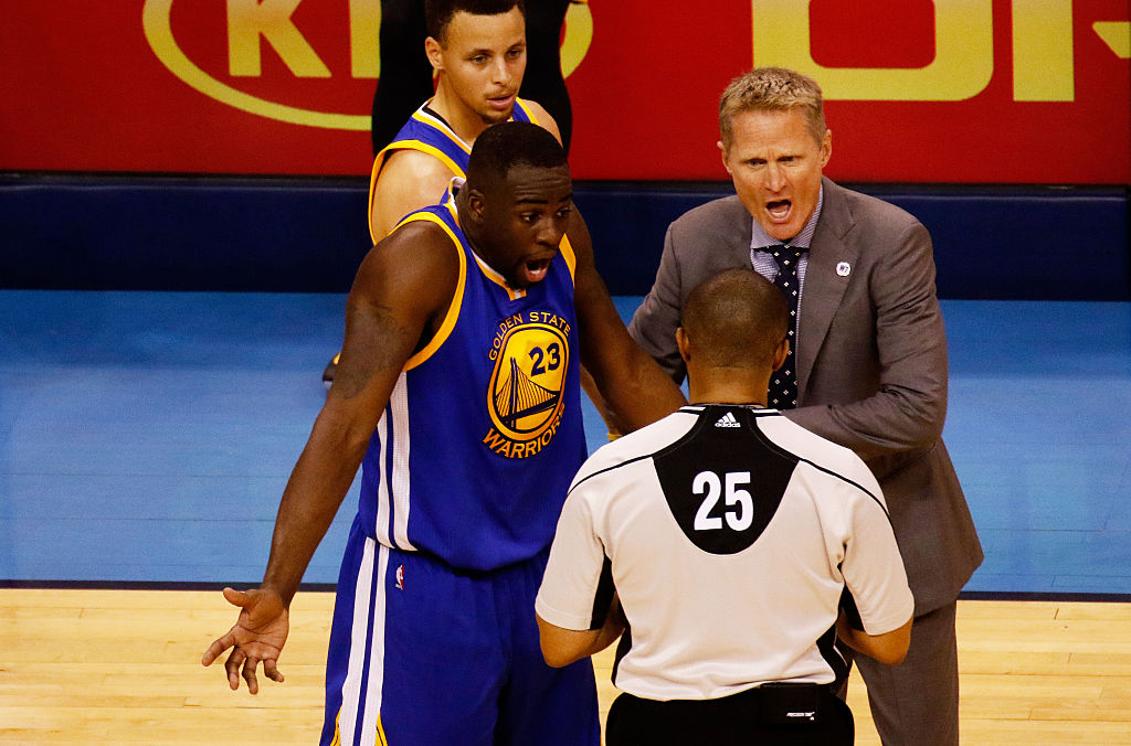 with referee Tony Brothers in the second quarter against the Oklahoma City Thunder in Game Three of the Western Conference Finals during the 2016 NBA Playoffs