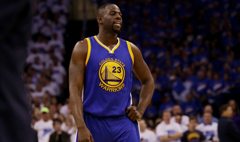 Draymond Green takes a breather on the court.