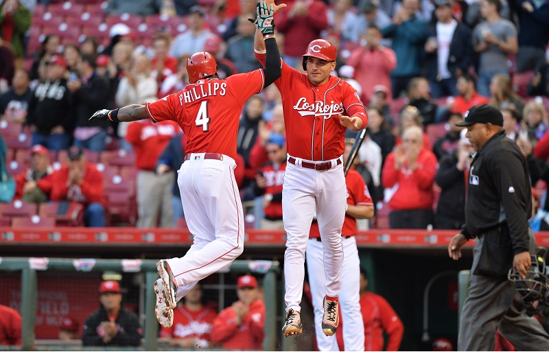CINCINNATI, OH - MAY 5: Brandon Phillips #4 and Joey Votto #19 of the Cincinnati Reds celebrate at home plate after Phillips hit a two-run home run in the second inning against the Milwaukee Brewers at Great American Ball Park on May 5, 2016 in Cincinnati, Ohio. (Photo by Jamie Sabau/Getty Images)
