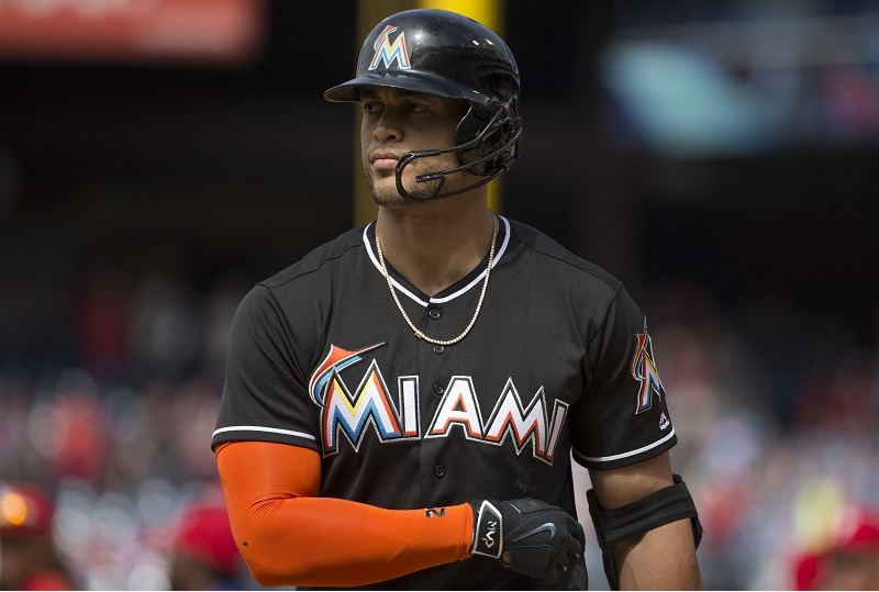 Giancarlo Stanton walks off the field.