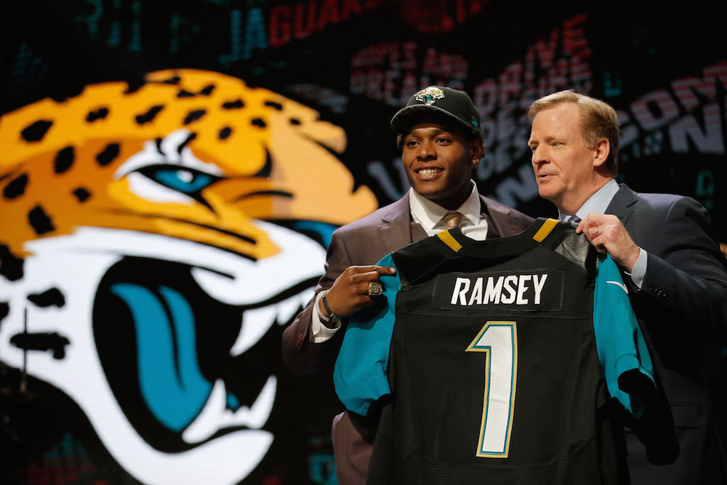 Jalen Ramsey of the Florida State Seminoles holds up a jersey with NFL Commissioner Roger Goodell after being picked #5 overall by the Jacksonville Jaguarsduring the first round of the 2016 NFL Draft at the Auditorium Theatre of Roosevelt University on April 28, 2016 in Chicago, Illinois.