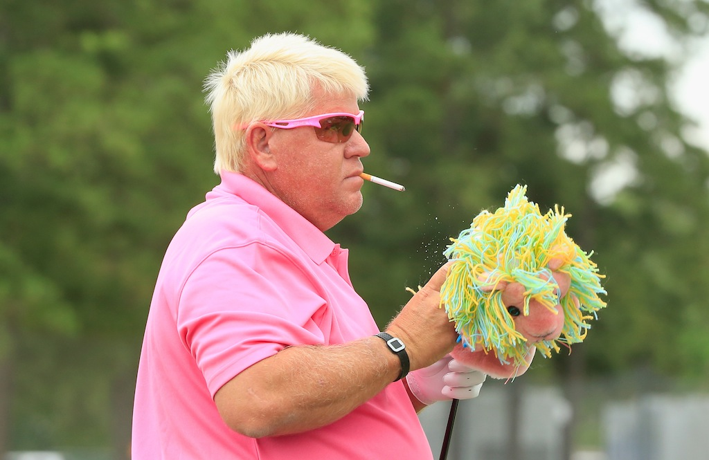 Infamous pro golfer John Daly waits on the practice ground during Insperity Invitational.