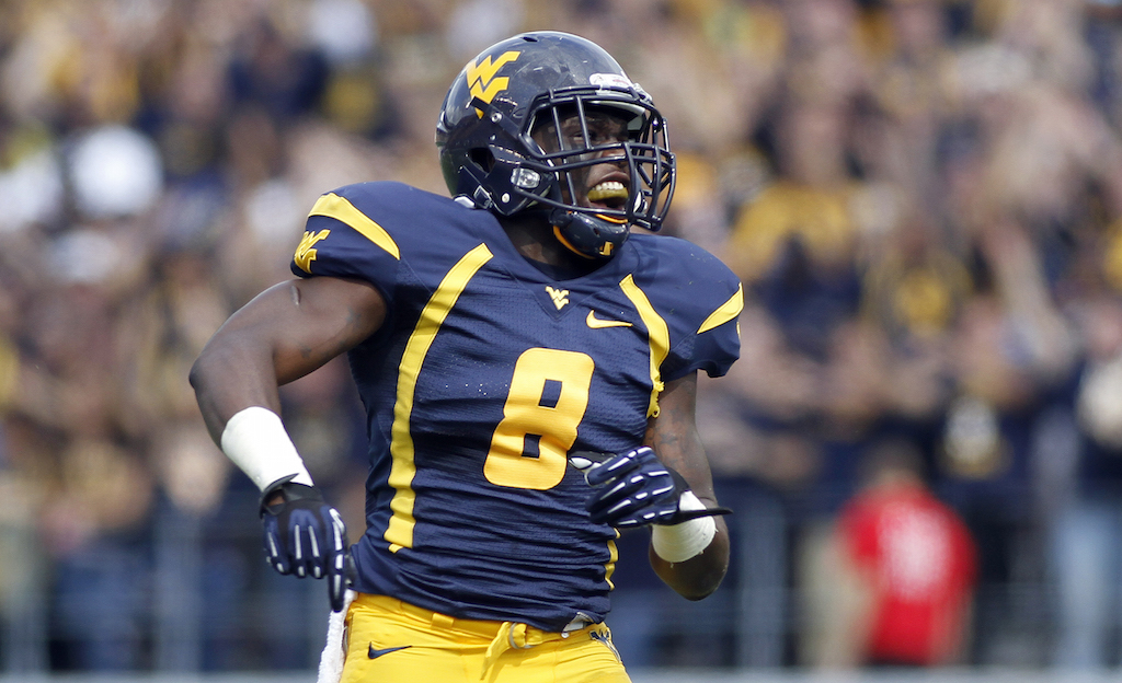Karl Joseph #8 of the West Virginia Mountaineers pumps up the crowd against the Baylor Bears during the game on September 29, 2012 at Mountaineer Field in Morgantown, West Virginia.