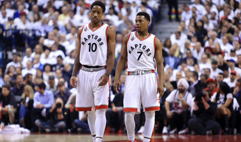 Kyle Lowry and DeMar DeRozan walk across the court.